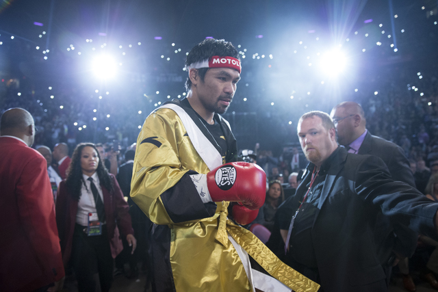 Manny Pacquiao steps to the ring for his fight against Jessie Vargas in the welterweight WBO World Title bout at the Thomas & Mack Center on Saturday, Nov. 5, 2016, in Las Vegas. Pacquiao won  ...