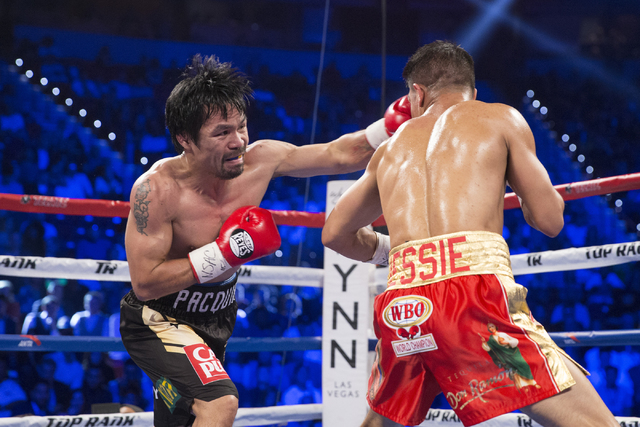 Manny Pacquiao, left, connects a left punch to knock down Jessie Vargas in their welterweight WBO World Title bout at the Thomas & Mack Center on Saturday, Nov. 5, 2016, in Las Vegas. Pacquiao ...
