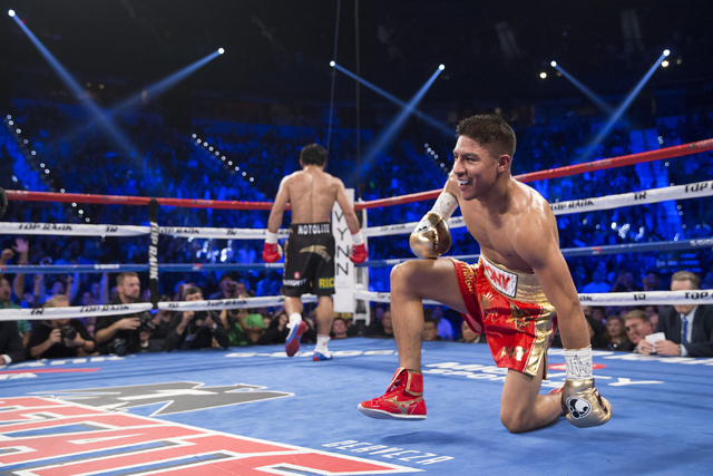 Jessie Vargas falls to his knees after a punch from Manny Pacquiao in their welterweight WBO World Title bout at the Thomas & Mack Center on Saturday, Nov. 5, 2016, in Las Vegas. Erik Verduzco ...