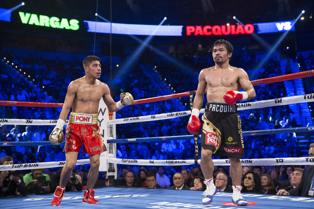 Jessie Vargas, left, looks at his opponent Manny Pacquiao at the end of a round in their welterweight WBO World Title bout at the Thomas & Mack Center on Saturday, Nov. 5, 2016, in Las Vegas.  ...