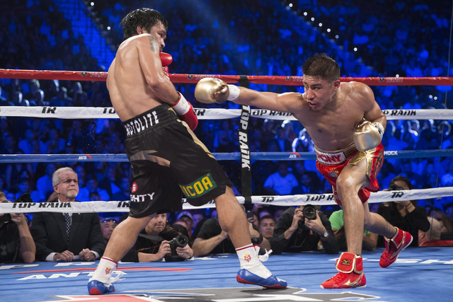 Jessie Vargas, right, throws a right punch against Manny Pacquiao in their welterweight WBO World Title bout at the Thomas & Mack Center on Saturday, Nov. 5, 2016, in Las Vegas. Pacquiao won b ...