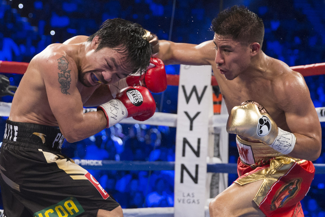Manny Pacquiao, left, battles Jessie Vargas in their welterweight WBO World Title bout at the Thomas & Mack Center on Saturday, Nov. 5, 2016, in Las Vegas. Pacquiao won by unanimous decision.  ...
