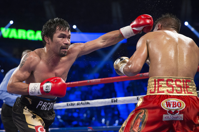 Manny Pacquiao, left, throws a punch against Jessie Vargas in their welterweight WBO World Title bout at the Thomas & Mack Center on Saturday, Nov. 5, 2016, in Las Vegas. Pacquiao won by unani ...