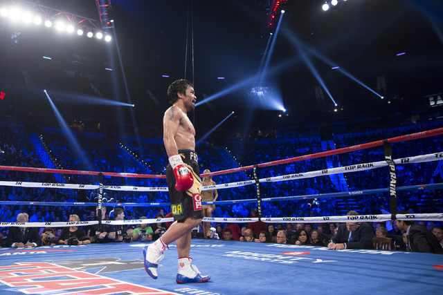 Manny Pacquiao walks to his corner in between rounds in his fight against Jessie Vargas in their welterweight WBO World Title bout at the Thomas & Mack Center on Saturday, Nov. 5, 2016, in Las ...