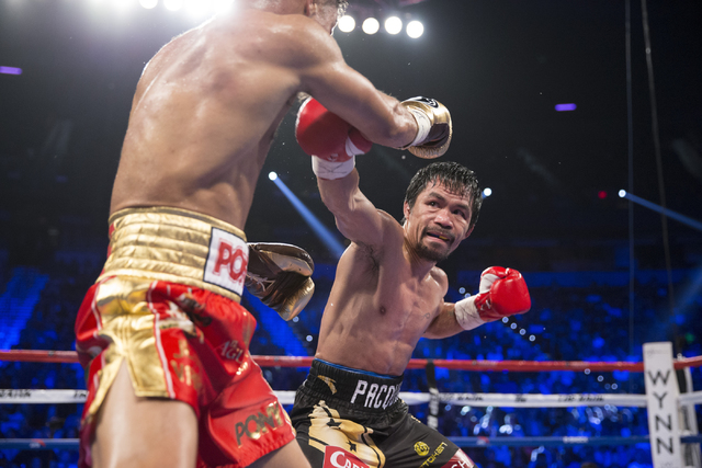 Jessie Vargas, left, battles Manny Pacquiao in their welterweight WBO World Title bout at the Thomas & Mack Center on Saturday, Nov. 5, 2016, in Las Vegas. Pacquiao won by unanimous decision.  ...