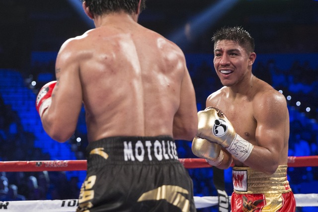 Jessie Vargas, right, looks at his opponent Manny Pacquiao in their welterweight WBO World Title bout at the Thomas & Mack Center on Saturday, Nov. 5, 2016, in Las Vegas. Pacquiao won by unani ...