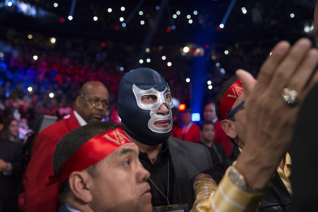 Mexican wrestler Blue Demon Jr. walks to the boxing ring to watch in support of Jessie Vargas in his fight against Manny Pacquiao in the welterweight WBO World Title bout at the Thomas & Mack  ...