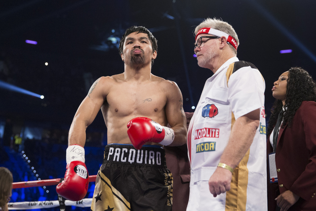 Manny Pacquiao, left, with his coach Freddie Roach gets ready for the start of his fight against Jessie Vargas in the welterweight WBO World Title bout at the Thomas & Mack Center on Saturday, ...