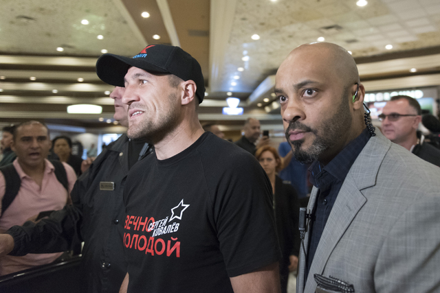 Boxer Sergey Kovalev, left, arrives at the MGM Grand hotel-casino in Las Vegas, Tuesday, Nov. 15, 2016. Sergey Kovalev and Andre Ward will fight for the Unified Light Heavyweight World Championshi ...