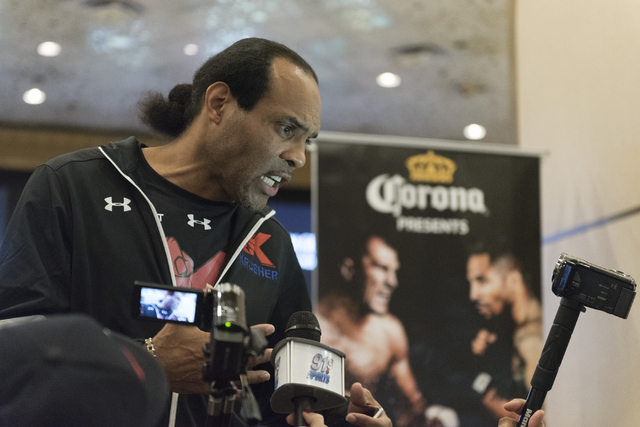 Boxer Sergey Kovalev's trainer, John David Jackson speaks with media at the MGM Grand hotel-casino in Las Vegas, Tuesday, Nov. 15, 2016. Sergey Kovalev and Andre Ward will fight for the Unified Li ...