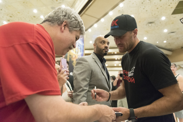 Boxer Sergey Kovalev signs an autograph for a fan following speaking with media at the MGM Grand hotel-casino in Las Vegas, Tuesday, Nov. 15, 2016. Sergey Kovalev and Andre Ward will fight for the ...