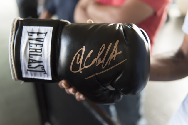 A fan shows off a boxing glove signed by Sergey Kovale at the MGM Grand hotel-casino in Las Vegas, Tuesday, Nov. 15, 2016. Sergey Kovalev and Andre Ward will fight for the Unified Light Heavyweigh ...