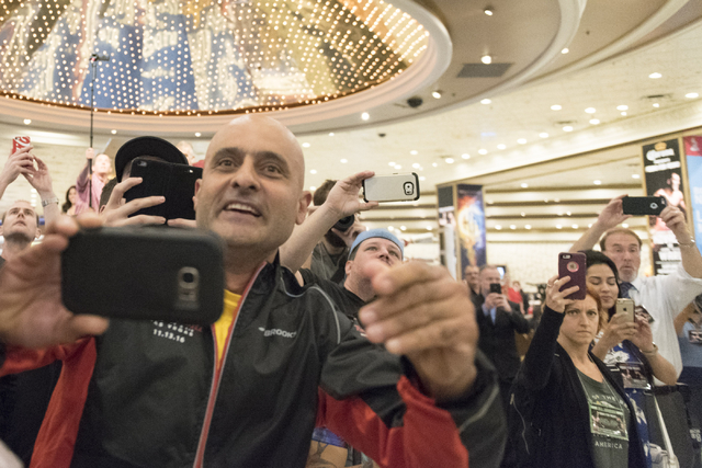 Fans take photos as boxer Andre Ward arrives at the MGM Grand hotel-casino in Las Vegas, Tuesday, Nov. 15, 2016. Sergey Kovalev and Andre Ward will fight for the Unified Light Heavyweight World Ch ...