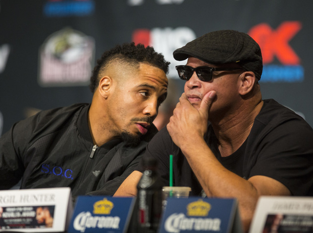Andre Ward, left, talks with trainer Virgil Hunter on during a press conference at the MGM Grand hotel-casino in Las Vegas on Thursday, Nov. 17, 2016. Ward is scheduled to fight Sergey Kovalev at  ...
