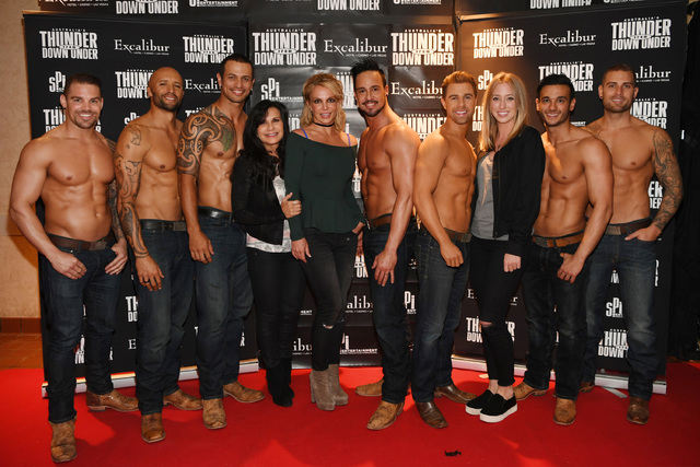 """Britney Spears is shown next to her mother, Lynn,  and her personal assistant, Sarah Mitchell (third from right) with the cast of """"Thunder from Down Under"""" at Excalibur on Thursday night. (Courtes ..."""
