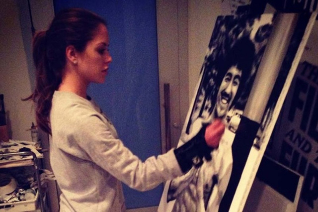 Brittney Palmer works on her art. (Courtesy UFC)
