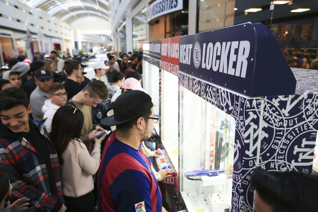 Shoppers line up to play arcade games with shoes for prizes during Black Friday at Boulevard Mall in Las Vegas on Nov. 25, 2016. (Brett Le Blanc/Las Vegas Review-Journal) Follow @bleblancphoto