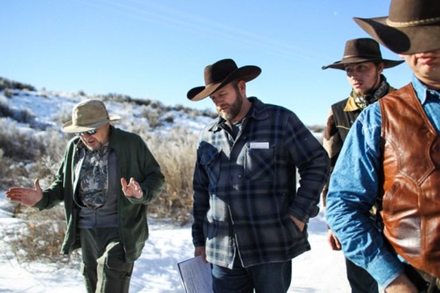 Steve Atkins, left, of Burns, Oregon, voices his discontent over the occupation with Ammon Bundy, center, and Ryan Bundy, far right, at Malheur National Wildlife Refuge headquarters near Burns, Or ...