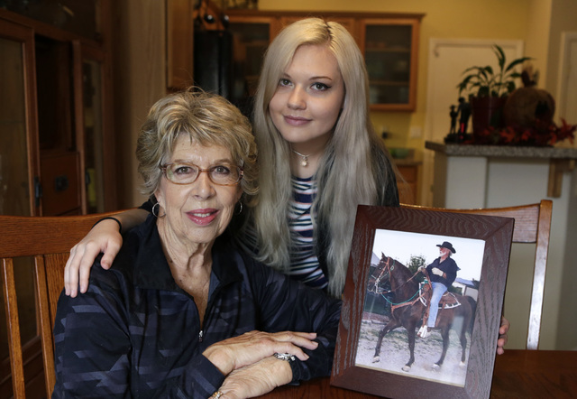 Cancer advocate Sherry Jasperson, left, poses for a photo with her granddaughter Kate Rasmussen, 18, next to her husband John's photograph at their home Friday, Oct. 28, 2016, in Las Vegas. Bizuay ...