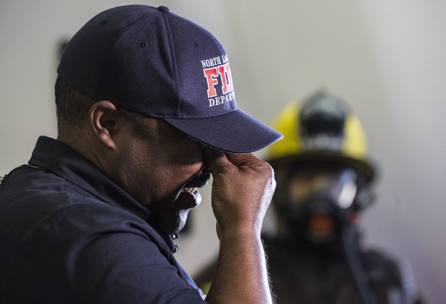 Captain Cedric Williams, the public information officer for the North Las Vegas Fire Department, wipes away tears during a press conference to announce the death of his friend and colleague Captai ...