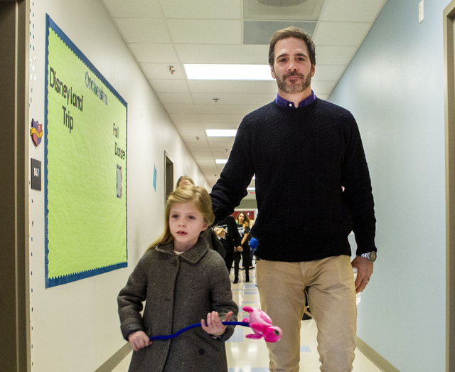 Jimmie Johnson, reigning NASCAR Sprint Cup Series Champion, and daughter Genevieve Marie Johnson, walk through the halls of Doral Academy Red Rock - Upper/High School on Wednesday, Nov. 30, 2016,  ...