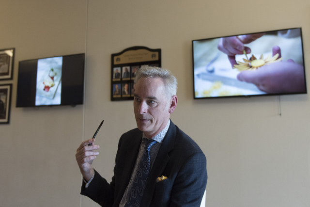 Timothy S. Harlan, executive director with the Goldring Center for Culinary Medicine at Tulane University, speaks with a reporter during a cooking class for the Primary Care Cardiometabolic Risk S ...