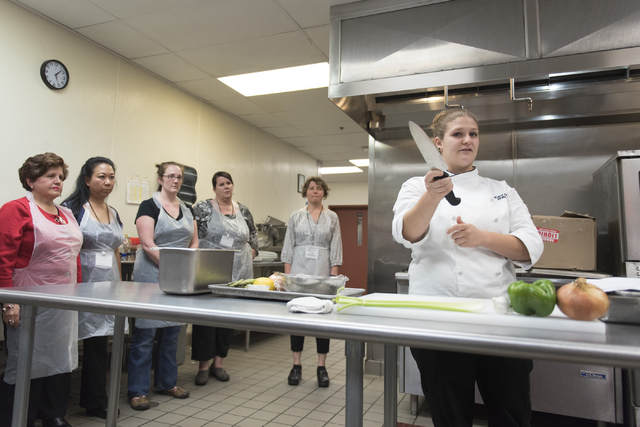 Kerri Dotson, chef and registered dietitian with the Goldring Center for Culinary Medicine at Tulane University, demonstrates proper cutting technique during a cooking class for the Primary Care C ...