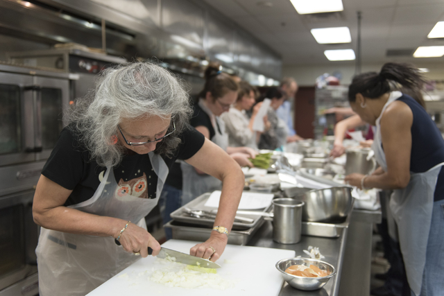 Mary Dickson cuts an onion during a cooking class for the Primary Care Cardiometabolic Risk Summit at the Culinary Academy of Las Vegas, Sunday, Oct. 16, 2016. The cooking class is called &quo ...