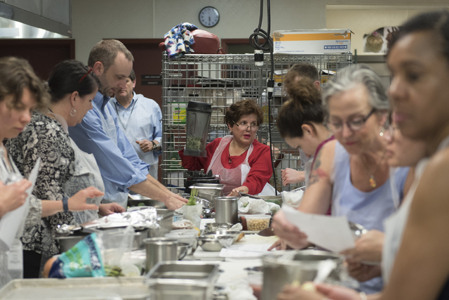 Participants prepare meals based on patient casework during a cooking class for the Primary Care Cardiometabolic Risk Summit at the Culinary Academy of Las Vegas, Sunday, Oct. 16, 2016. The cookin ...