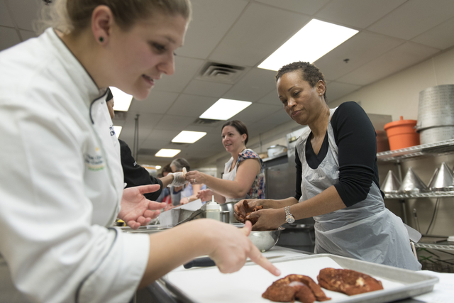 Marleece Barber, right, prepares Moroccan spiced broiled chicken with the help of Kerri Dotson, chef and registered dietitian with the Goldring Center for Culinary Medicine at Tulane University, d ...