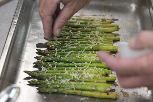 Mike Deneff prepares roasted asparagus during a cooking class for the Primary Care Cardiometabolic Risk Summit at the Culinary Academy of Las Vegas, Sunday, Oct. 16, 2016. The cooking class is cal ...