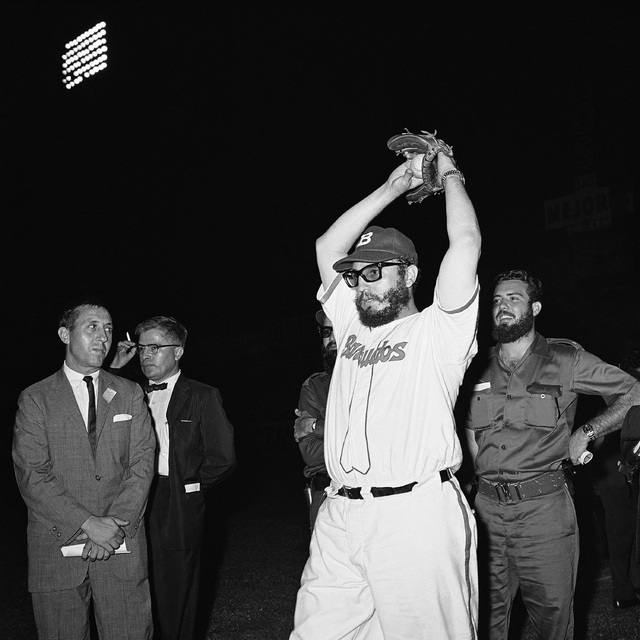 Fidel Castro wearing the uniform of the Barbudos army baseball team takes warm-up pitches before the start of the short exhibition game at night on July 24, 1959 in Havana, Cuba. Castro pitched on ...