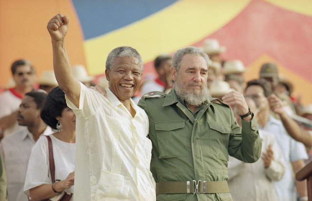 "Cuban President Fidel Castro, right, and African leader Nelson Mandela gesture during the celebration of the ""Day of the Revolution"" in Matanzas Saturday, July 27, 1991. Cubans c ..."