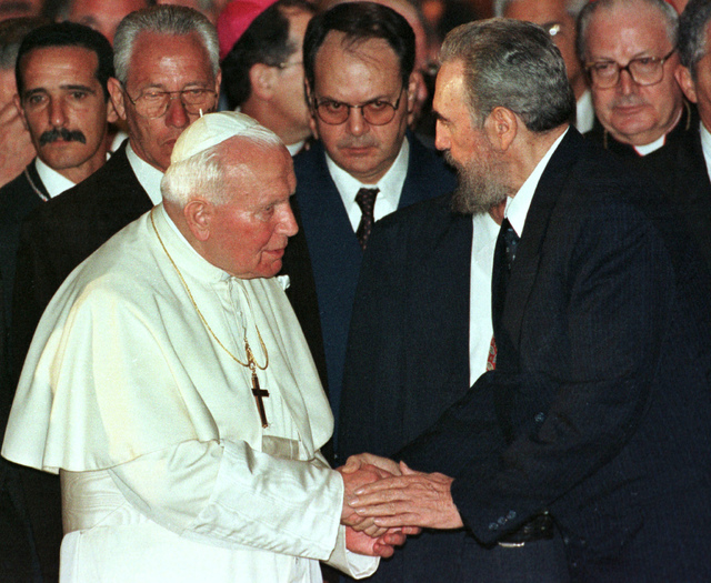 Cuban President Fidel Castro, right, and Pope John Paul II are seen during a ceremony at the Havana's University in Cuba in this January 1998 file photo. (AP  Photo/Jose Goitia) **EFE OUT**