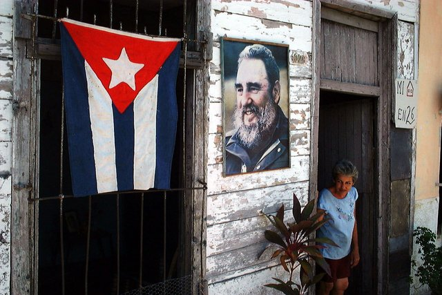 "A house is decorated with the image of Cuban leader Fidel Castro and the Cuban flag in Cienfuegos, Cuba, Monday July 26, 1999 to mark the official holiday of ""July 26"" in Cuba. (AP Photo/Jose Goitia)"