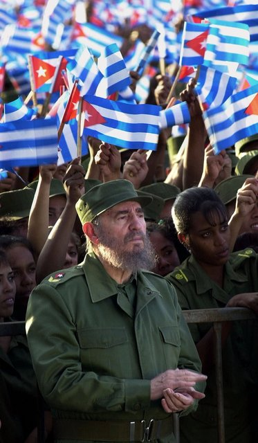 Cuban leader Fidel Castro applauds during a rally to demand the return of six-year-old Elian Gonzalez at a Havana military school Tuesday, Jan. 25, 2000. (AP Photo/Gregory Bull)