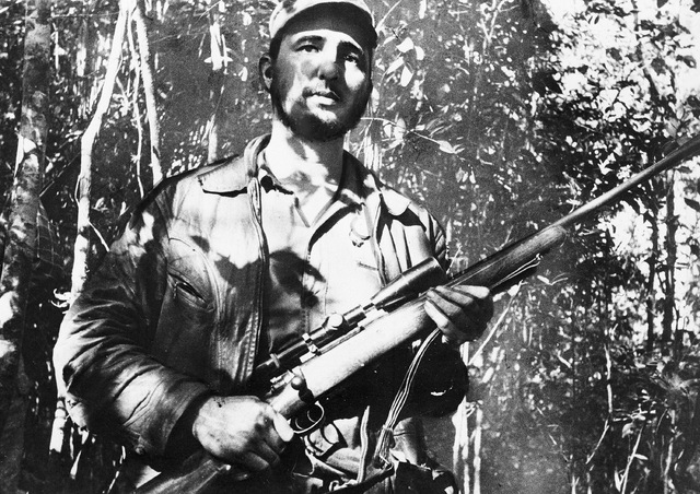 In this Feb. 26, 1957 file photo, Cuba's leader Fidel Castro stands in an unknown location in Cuba. (AP Photo)