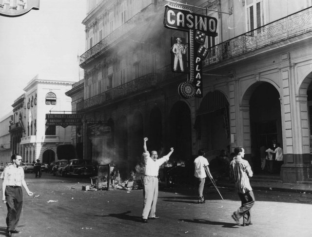 People burn tables and roulette wheels outside the Plaza Hotel Casino in Old Havana, Cuba, in Jan. 1959, shortly after revolutionary leader Fidel Castro gained power. On Jan. 1, 1959, dictator Ful ...