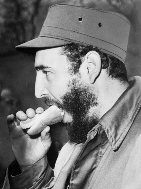 Cuban Prime Minister Fidel Castro, visiting the U.S., takes a good sized bite of hot dog during a trip to New York's Bronx Zoo April 24, 1959.  Hot dogs are not unknown to Cuba, but are not nearly ...