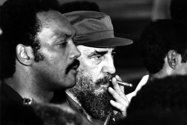 U.S. Presidential candidate Jesse Jackson, left, and Cuban President Fidel Castro face reporters at Jose Marti Airport after Castro released Cuban and American prisoners to Jackson in Havana, Cuba ...