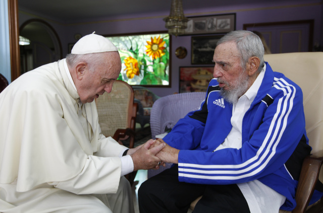 Pope Francis holds hands with Fidel Castro in Havana, Cuba, Sunday, Sept. 20, 2015. The Vatican described the 40-minute meeting at Castro's residence as informal and familial, with an exchange of  ...