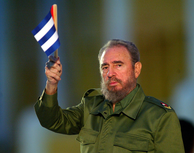 Cuban President Fidel Castro holds a Cuban flag at the beginning of his speech in this  Saturday July 26, 2003 file photo in Santiago de Cuba, eastern Cuba. (AP Photo/Jose Goitia)