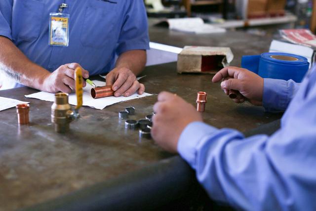 Eddie Rodriguez, right, gathers parts at Larkin Plumbing for Eric Jenkins, left, to fix a water line in Las Vegas on Thursday, Nov. 3, 2016. Brett Le Blanc/Las Vegas Review-Journal Follow @bleblan ...
