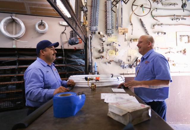 Eddie Rodriguez, left, gathers parts at Larkin Plumbing for Eric Jenkins, right, to fix a water line in Las Vegas on Thursday, Nov. 3, 2016. Brett Le Blanc/Las Vegas Review-Journal Follow @bleblan ...