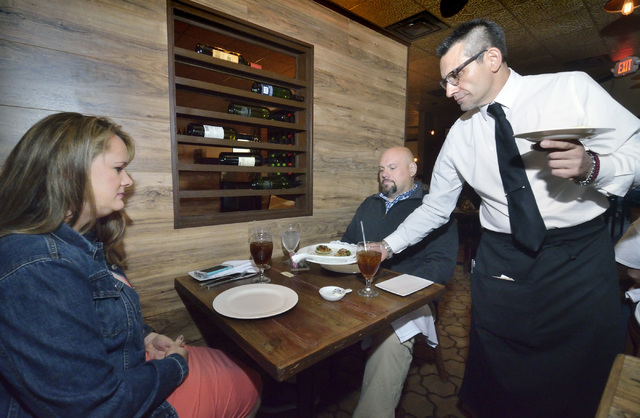 Sommelier Lino Amato, right, serves Kelly Jacks, left, and her husband Joel at Chef Marc's Trattoria at 8615 W. Sahara Ave. in Las Vegas on Saturday, Oct. 29, 2016. Bill Hughes/Las Vegas Re ...