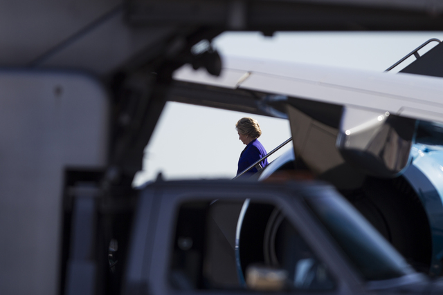 Democratic presidential nominee Hillary Clinton steps down from her campaign's plane at McCarran International Airport on Wednesday, Nov. 2, 2016, in Las Vegas. Erik Verduzco/Las Vegas Review-Jour ...