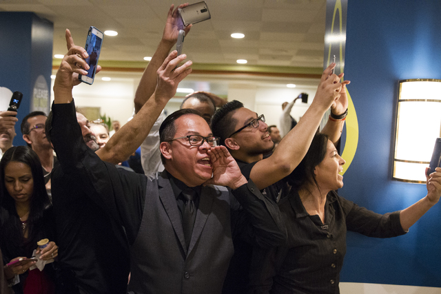 Employees cheer for Democratic presidential nominee Hillary Clinton during a surprise stop to The Mirage hotel-casino on Wednesday, Nov. 2, 2016, in Las Vegas. Erik Verduzco/Las Vegas Review-Journ ...