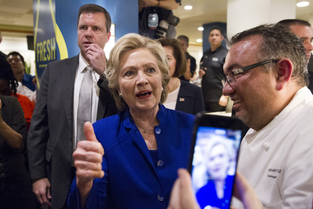 Democratic presidential nominee Hillary Clinton gestures to employees during a surprise stop to The Mirage hotel-casino on Wednesday, Nov. 2, 2016, in Las Vegas. Erik Verduzco/Las Vegas Review-Jou ...