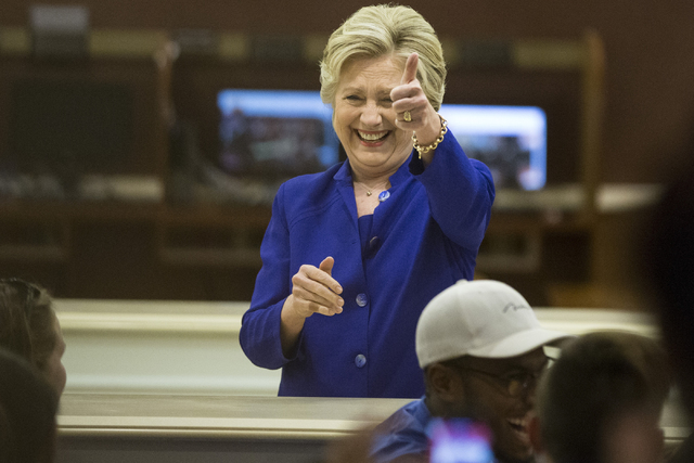 Democratic presidential nominee Hillary Clinton gestures at a group of employees as she enters the room during a surprise stop to The Mirage hotel-casino on Wednesday, Nov. 2, 2016, in Las Vegas.  ...