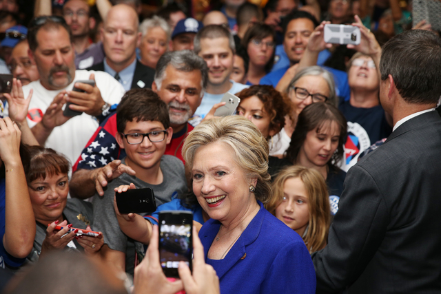 Democratic presidential nominee Hillary Clinton poses with supporters after speaking during a campaign rally at the Plumbers & Pipefitters Training Center on Wednesday, Nov. 2, 2016, in Las Ve ...